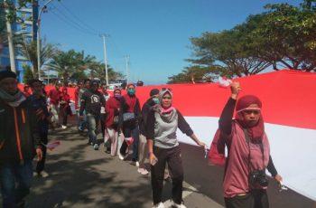 Kegiatan kirab Bendera Merah Putih oleh Aliansi Pemuda Ulu Ere.