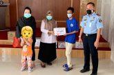 Pemberian bantuan kepada WBP Rutan Klas I Makassar.